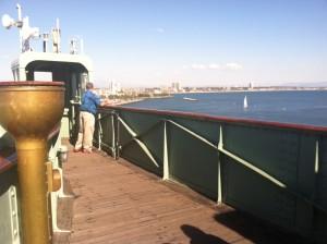 Dad peering into Pacific Ocean
